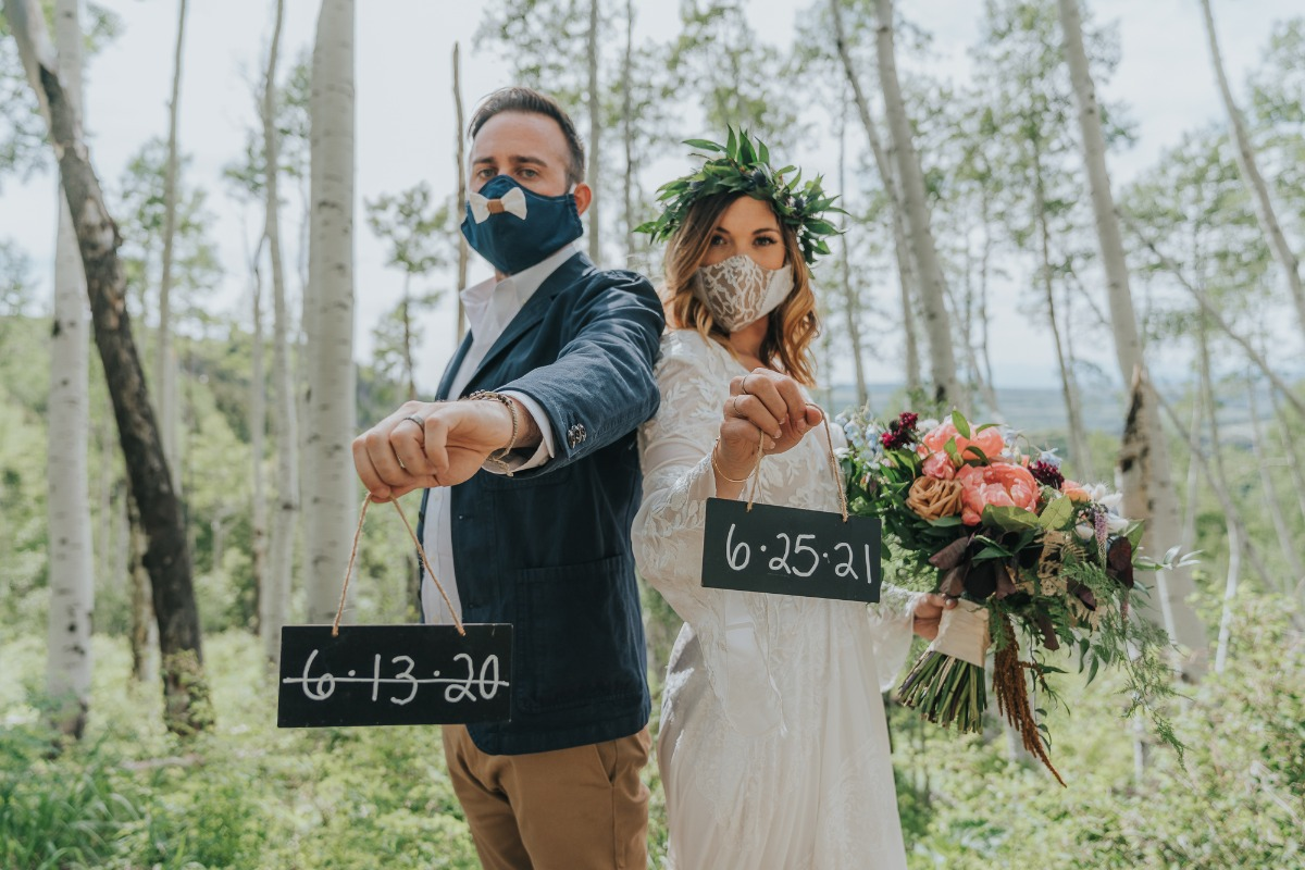 change of date wedding sign