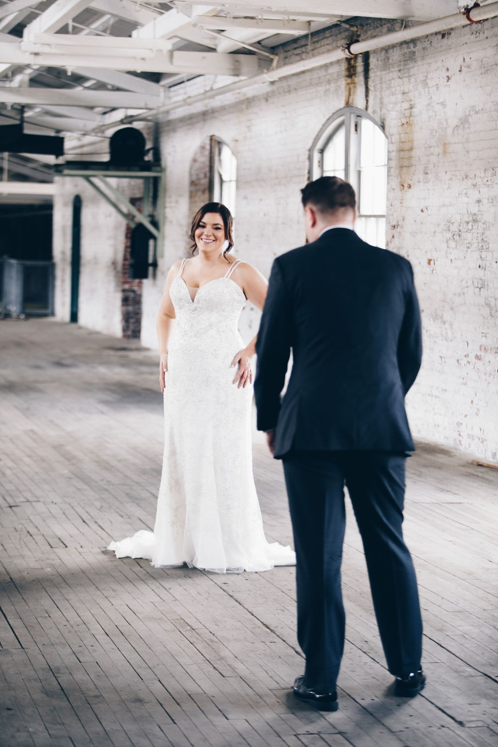 bride and groom first wedding look