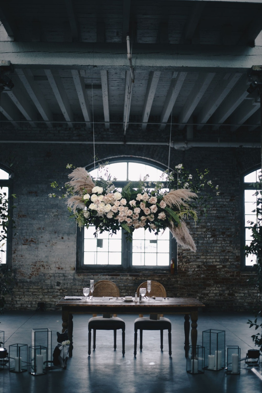 sweetheart table with hanging floral instillation