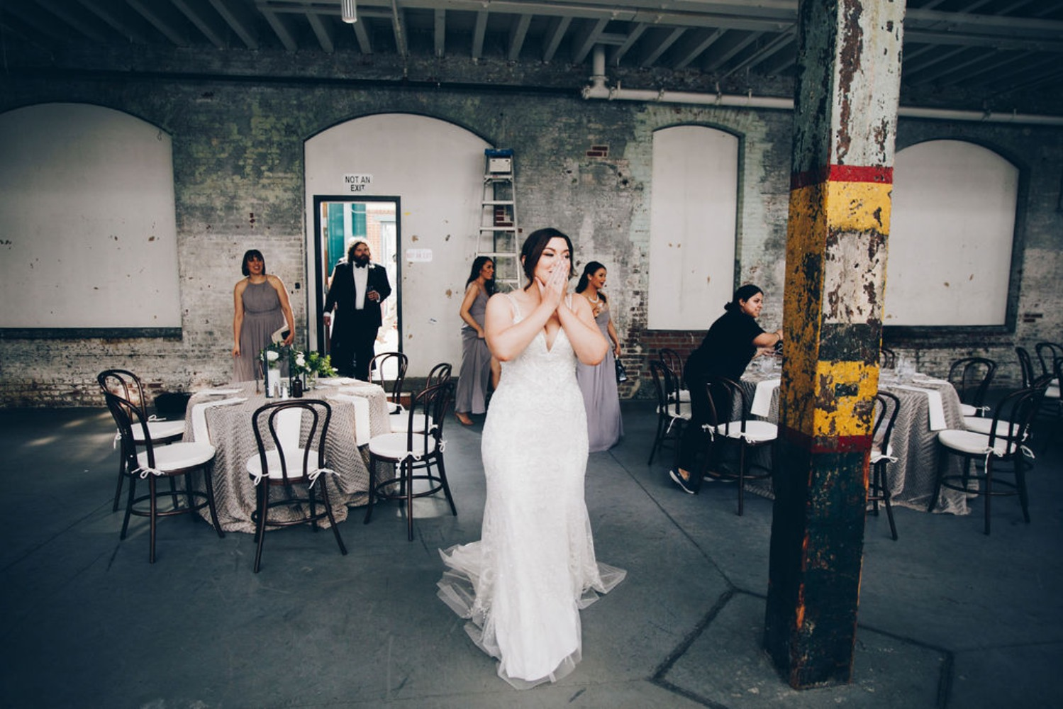bride's first view of her wedding reception decor