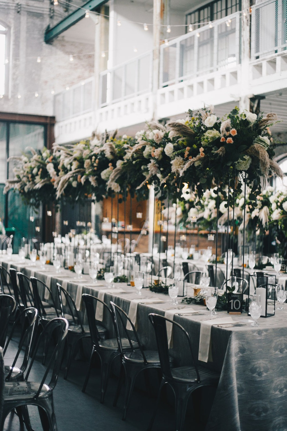 tall wedding centerpieces at industrial venue