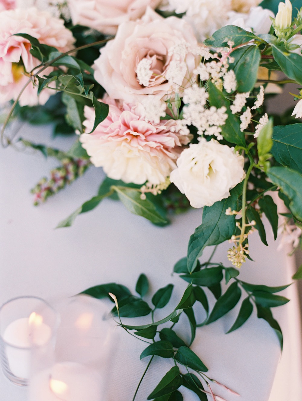 welcome wedding table with florals
