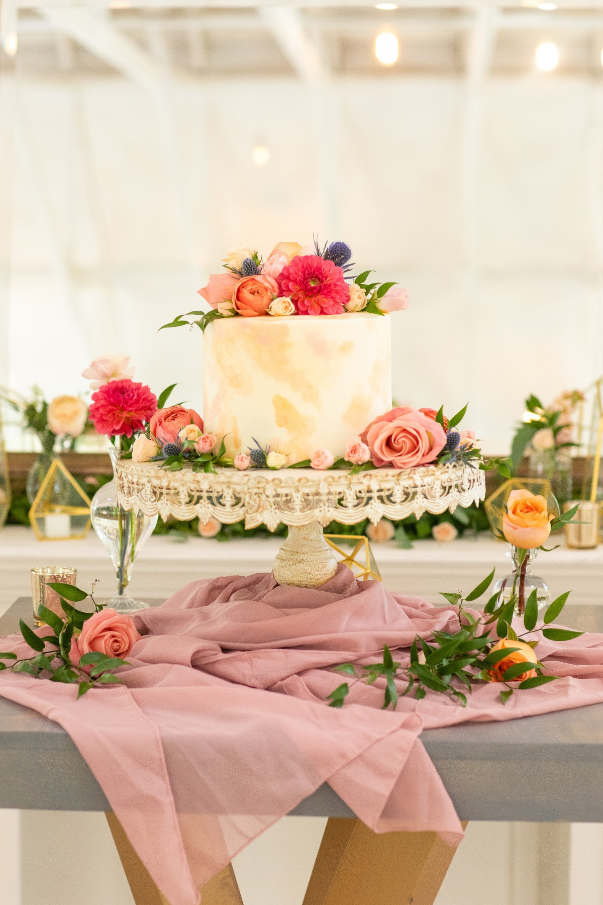 watercolor wedding cake adorned with florals