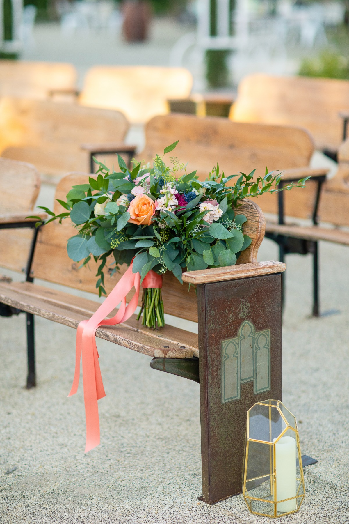 church pews used at outdoor wedding ceremony