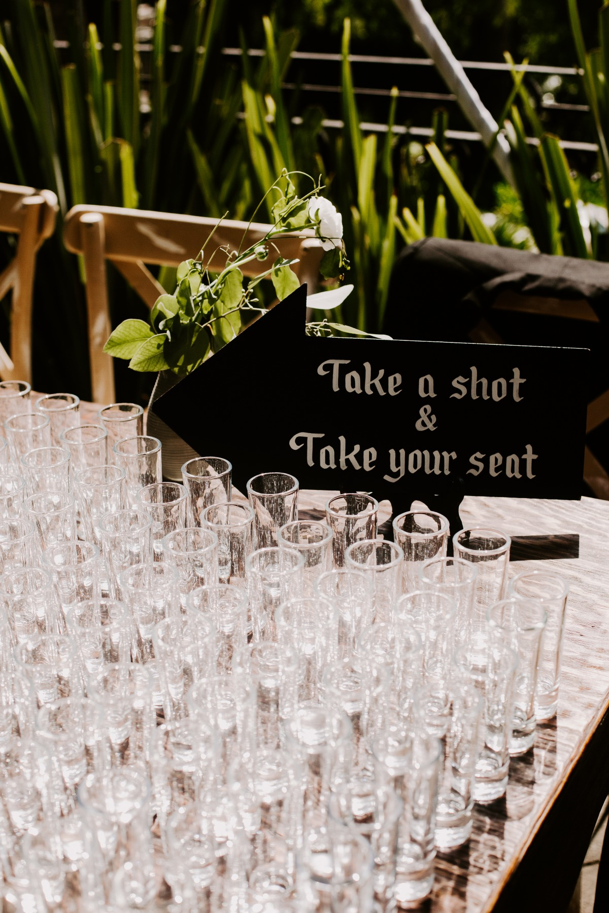 Take a shot and take your seat wedding sign