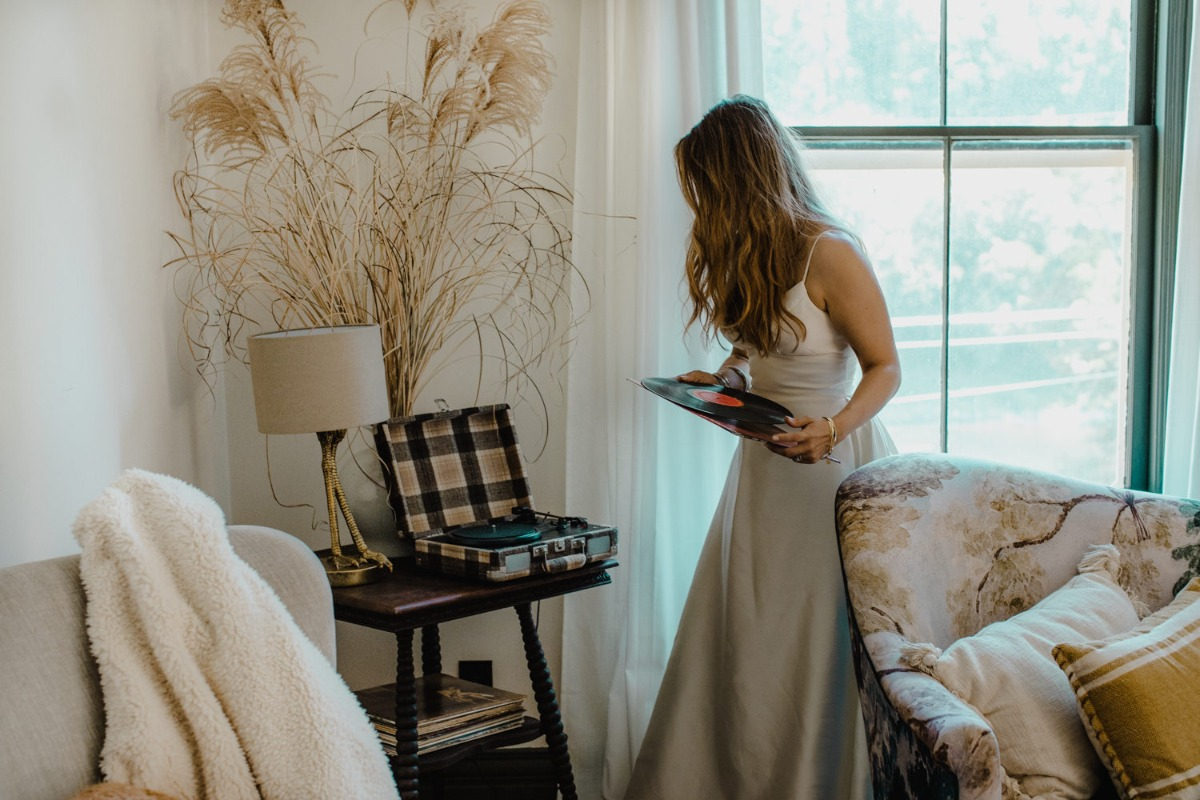 bride getting wedding ready and listening to records