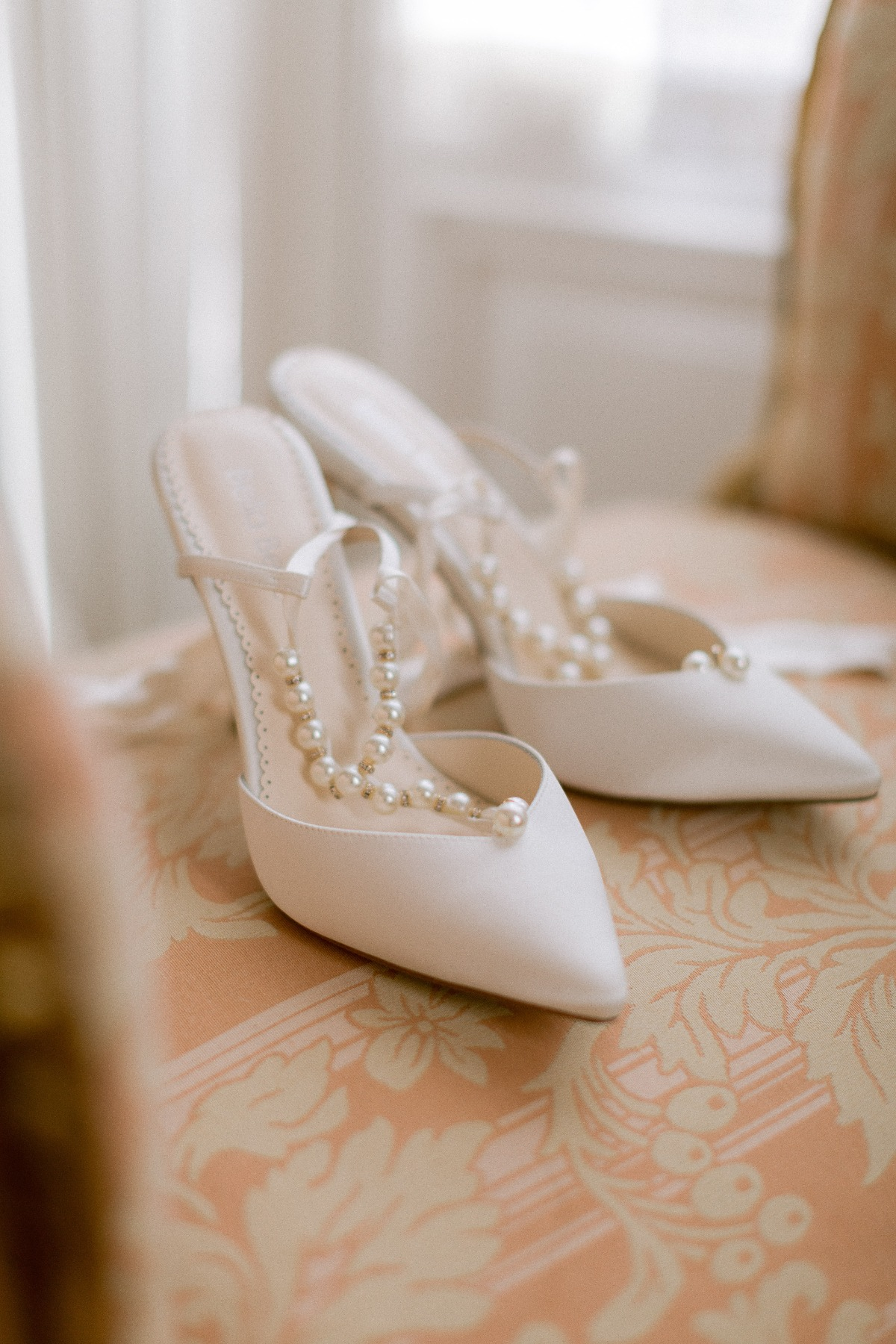 white wedding shoes with pearl straps