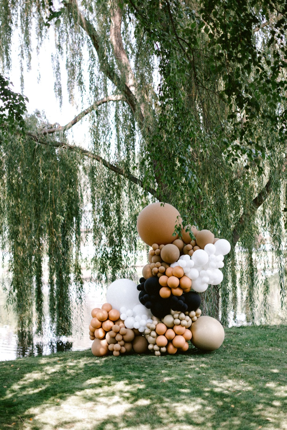 black, gold and white balloon instillation