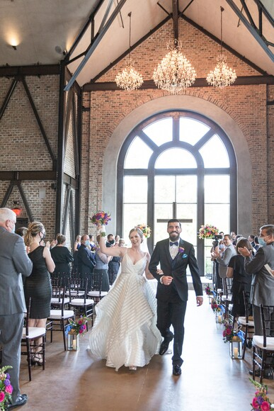 A Tuscan Inspired Wedding Venue With Bright Florals and Two Cakes
